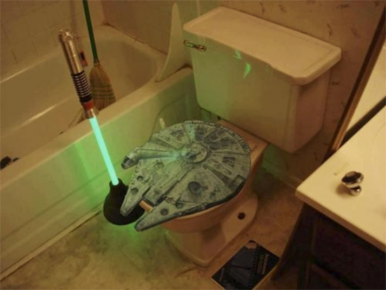 Millenium Falcon toilet seat and lightsaber toilet plunger