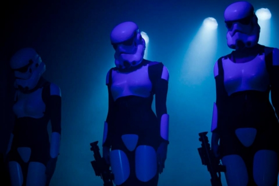 Three sexy Stormtroopers in a spotlight