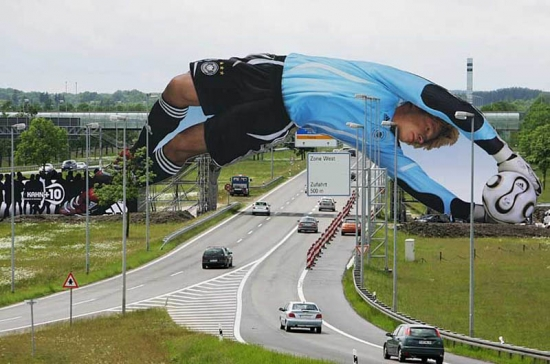 creative billboard over a road