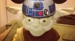 Yoda wearing an R2D2 hat